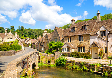 Castle Combe Water lane with bridge over By brook on to The Street Castle Combe village Castle Combe Cotswolds Wiltshire england