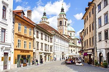 People walking towards Roman Catholic Cathedral (Ljubljana Cathedral) on Cyril Methodius Square, Old Town, Ljubljana, Slovenia, Europe