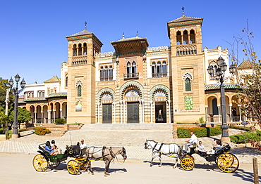 Tourists on a sightseeing carriage ride outside the Museum of Popular Arts and Traditions, Seville, Andalusia, Spain, Europe