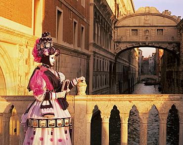Carnival costume and the Bridge of Sighs, Venice, Veneto, Italy, Europe