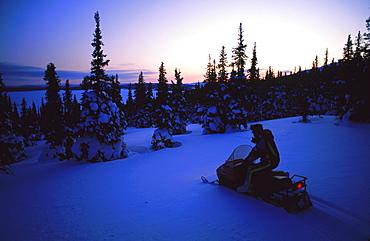 Snowmobile at twilight, Mount Otish