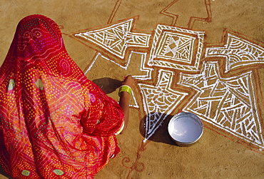 """Woman painting a Mandala design on the ground, near Jodhpur, Rajasthan, India""""Mandalas are symbolic diagrams used in Hindu and Buddhist Tantrism and meditation, A mandala is basically a representation of the Universe"""""""