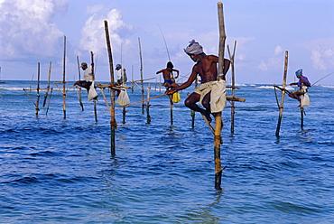 Stilt fishermen at Welligama, south coast, Sri Lanka, Indian Ocean, Asia