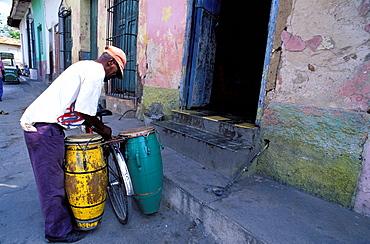 Cyclist, percussion player, UNESCO World Heritage site, Trinidad, Region of Sancti Spiritus, Cuba, Central America