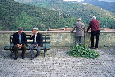 Men watching procession, Desulo (Gennargentu), Sardinia, Italy, Europe