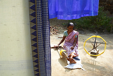 Woman working on silk weaving for sari production in a village around Jangipur, West Bengal, India, Asia