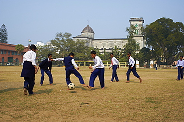 Students playing football, Sacred Heart church, Chandernagor (Chandannagar), a former French colony, West Bengal, India, Asia