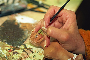 Painting small statuette, Santon, Bouches du Rhone, Provence, France, Europe