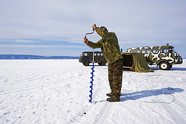 Fishing on the ice, Maloe More (Little Sea), frozen lake during winter, Olkhon island, Lake Baikal, UNESCO World Heritage Site, Irkutsk Oblast, Siberia, Russia, Eurasia