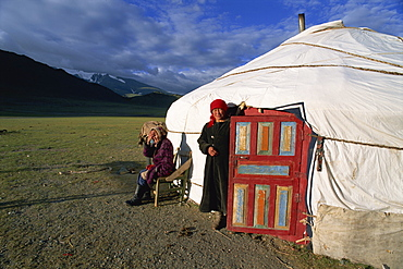 Two women outside a ger (yurt), Camp Kazakh, Khovd Gol valley, Bayan-olgii, Mongolia, Central Asia, Asia