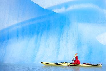 Person kayaking near icebergs, Lago Gray (Lake Gray) (Lake Grey), Torres del Paine National Park, Patagonia, Chile, South America