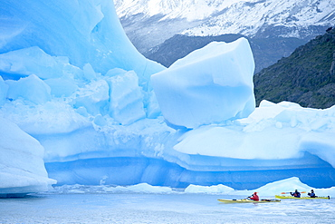 People kayaking near floating icebergs, Lago Gray (Lake Gray), Torres del Paine National Park, Patagonian Andes, Patagonia, Chile, South America