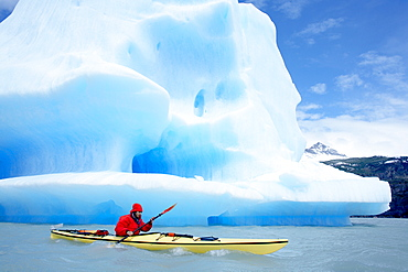 Person kayaking near floating icebergs, Lago Gray (Lake Gray), Torres del Paine National Park, Patagonian Andes, Patagonia, Chile, South America