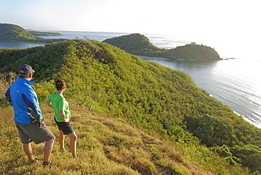 Couple viewing island beauty from the top, Drawaqa Island, Yasawa island group, Fiji, South Pacific islands, Pacific