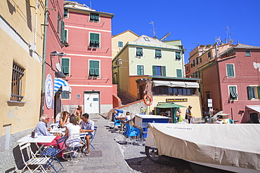 People dining at cafe in Boccadasse fishing village, Genoa, Liguria, Italy, Europe