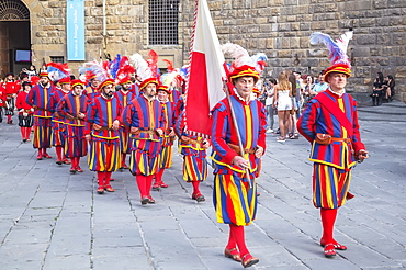 Men marching in costume during Calcio Storico Fiorentino festival at Piazza della Signoria in Florence, Tuscany, Italy, Europe