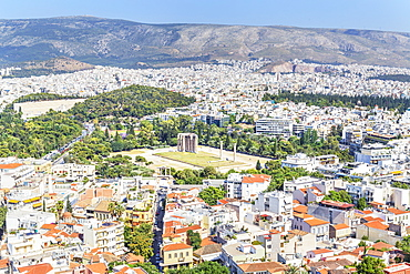 High angle view of Temple of Olympian Zeus, Hadrian's Arch and Athens city centre, Athens, Greece, Europe