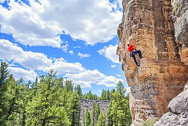 Man rock climbing at The Pit (Le Petit Verdon) in Sandy's Canyon, Flagstaff, Arizona, United States of America, North America
