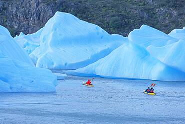 Kayakers paddles among icebergs, Torres del Paine National Park, Patagonia, Chile, South America