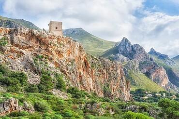 Defensive tower and mountain landscape, Macari, San Vito lo Capo, Sicily