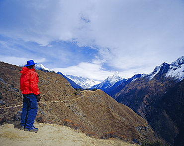Trekker looking at Ama Dablan and other mountains of the Himalayas, Hotel Everest view, Namche Bazaar, Nepal