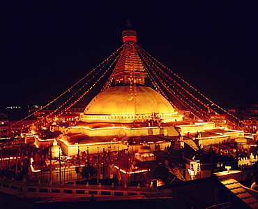 Buddhist stupa lit by candles at night, Bodnath, Kathmandu, Nepal, Asia