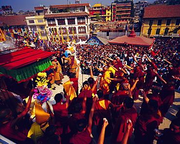 Buddist celebration of Losar (Tibetian New Year) where Buddists throw flower in the air, Bodnath, Katmandu, Nepal, Asia