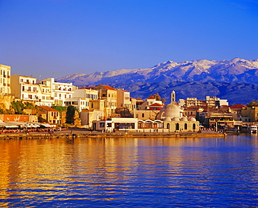 Hania seafront and Levka Ori (White Mountains) in the background, Hania, Crete, Greece