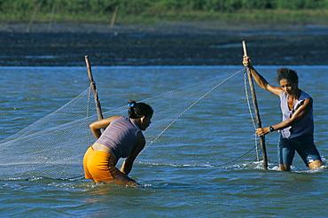 Women trapping fish with nets, Parque Nacional dos Lencois Maranhenses, near Atins, Lencois Maranhenses, Brazil, South America