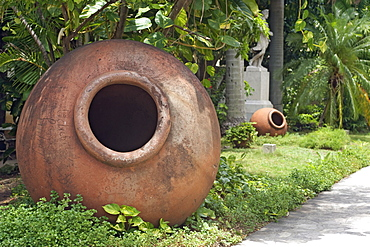 Dated 1856, these clay jars called tinajones, were used for storing liquids and foods, now lying in the gardens of what was originally the villa of JosŽ Gomez Mena, built in 1927, now the Museum of Decorative Arts, Vedado, Havana, Cuba, West Indies, Central America