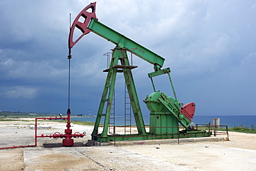 An on-shore oil pump along the coast east of Havana, Cuba, West Indies, Central America