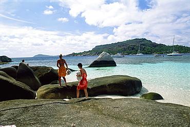 Tourists on rocks, Coco island, Praslin, Seychelles, Indian Ocean, Africa