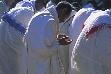 Christian men at prayer during Mass in the church at Woolisso, Gourague country, Shoa province, Ethiopia, Africa