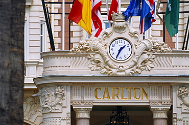Clock and flags at the Carlton Hotel, Cannes, Alpes Maritimes, Provence, French Riviera, France, Europe