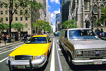 Yellow cab and truck, New York, USA