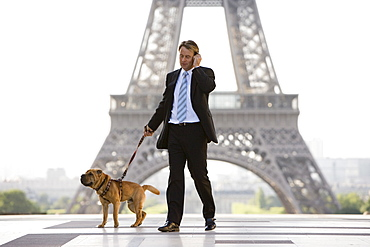 Business man with dog, Paris, France, Europe