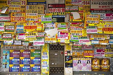 Bills posted on closed shop, Kowloon, Hong Kong, China, Asia