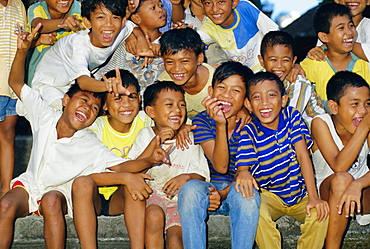 Portrait of a group of laughing boys, island of Bali, Indonesia, Southeast Asia, Asia