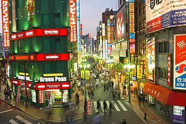 Busy streets and neon signs in the evening at Shinjuku station, Shinjuku, Tokyo, Japan, Asia