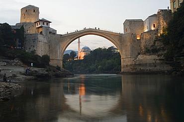 Stari Most Peace Bridge and reflection of mosque on Neretva River, Mostar, Bosnia, Bosnia-Herzegovina, Europe