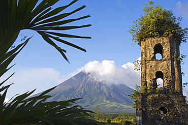 Church belfry ruins and volcanic cone with smoke plume of Mount Mayon, 2462m, Cagsawa, where 1200 people were buried alive in 1814 eruption, Bicol Province, Luzon Island, Philippines, Southeast Asia, Asia