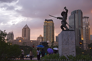 Monument of Soldier and city skyline at sunset, Makati Business District, Manila, Philippines, Southeast Asia, Asia