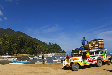 Colouful jeepney loading up at fishing boat harbour, Sabang Town, Palawan, Philippines, Southeast Asia, Asia