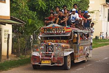 Jeepney truck with passengers crowded on roof, Coron Town, Busuanga Island, Palawan Province, Philippines, Southeast Asia, Asia