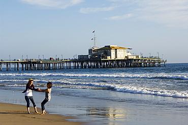 Girls enjoying the seaside near Santa Monica Pier, Santa Monica Beach, Los Angeles, California, United States of America, North America