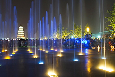Night time water show at the Big Goose Pagoda Park, Tang dynasty built in 652 by Emperor Gaozong, Xian City, Shaanxi Province, China, Asia
