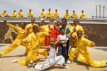 Kung fu students displaying their skills at a tourist show within Shaolin Temple, Shaolin is the birthplace of Kung Fu martial art, Shaolin, Henan Province, China, Asia