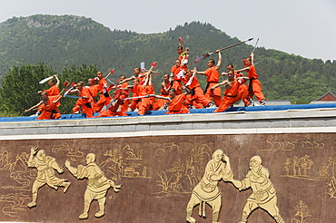 Kung fu students displaying their skills at a tourist show within Shaolin Temple, Shaolin, birthplace of Kung Fu martial art, Henan Province, China, Asia