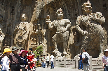 Carved Buddha images at Longmen Caves, Dragon Gate Grottoes, dating from the 6th to 8th Centuries, UNESCO World Heritage Site, Henan Province, China, Asia