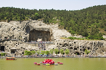 Carved Buddha images at Longmen Caves, Dragon Gate Grottoes, on the Yi He River dating from the 6th to 8th Centuries, UNESCO World Heritage Site, Henan Province, China, Asia